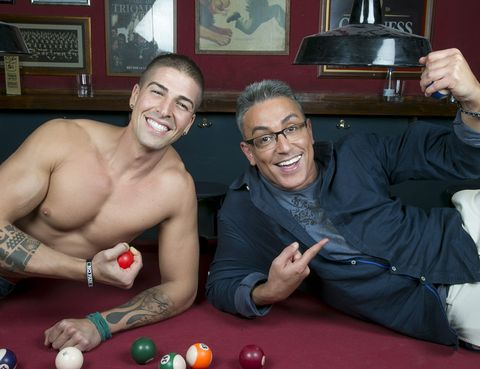 Arm, Smile, Glasses, Fun, Indoor games and sports, Hand, Wrist, Facial expression, Chest, Picture frame,