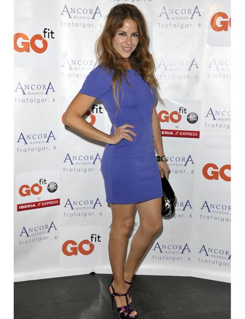 Dress, Hairstyle, Shoulder, Joint, Style, One-piece garment, Cocktail dress, High heels, Premiere, Electric blue,
