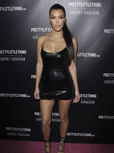 Clothing, Dress, Cocktail dress, Little black dress, Fashion model, Shoulder, Fashion, Beauty, Leg, Footwear,
