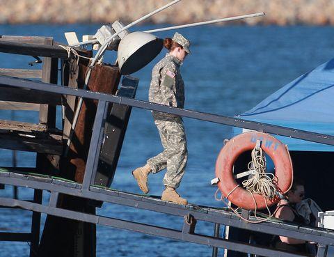 Military person, Marines, Naval architecture, Boot, Military, Rope, Boat, Deck, Military officer, Military uniform,