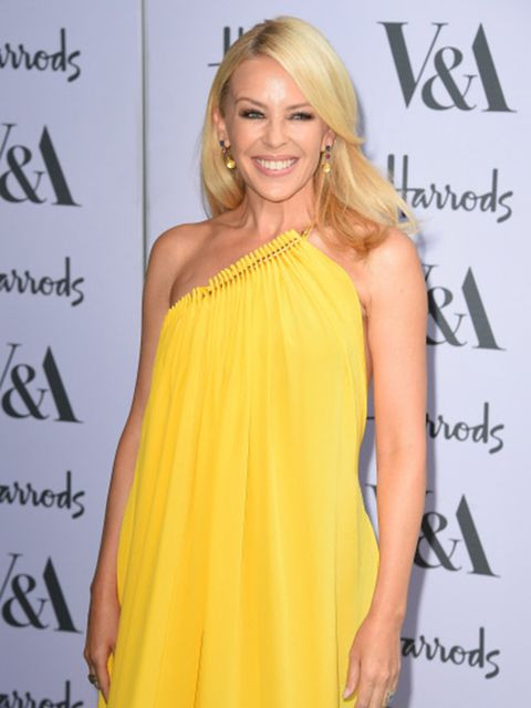 Clothing, Hair, Smile, Yellow, Hairstyle, Eye, Dress, Shoulder, Joint, Facial expression,