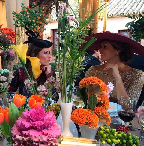 Nose, Hat, Flower, Petal, Floristry, Fashion accessory, Drink, Headgear, Wine glass, Cut flowers,
