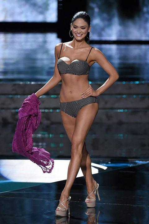 Leg, Skin, Human leg, Fashion show, Waist, Brassiere, Fashion model, Thigh, Runway, Abdomen,