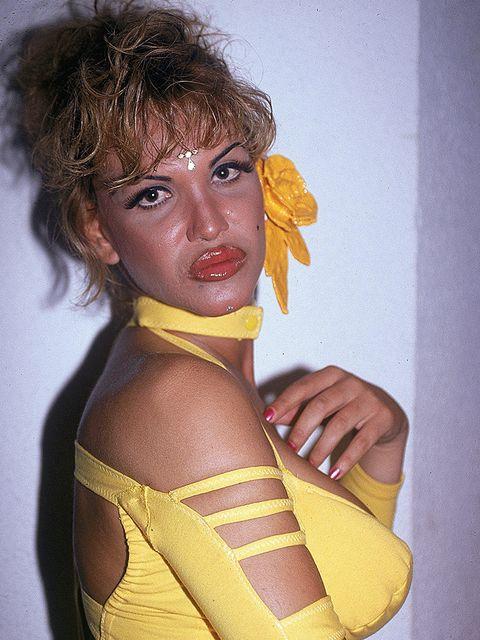 Yellow, Wrist, Bag, Shoulder bag, Painting, Costume, Portrait, Portrait photography, Self-portrait, Costume design,
