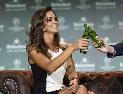Drink, Bottle, Glass bottle, Beer bottle, Alcohol, Hand, Drinkware, Alcoholic beverage, Beer, Logo,