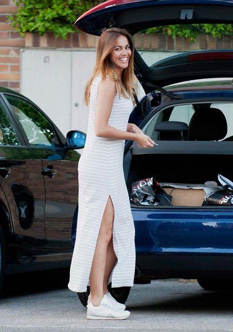 Clothing, Automotive design, Vehicle, Land vehicle, Dress, Shoulder, Car, Automotive exterior, Vehicle door, Hat,