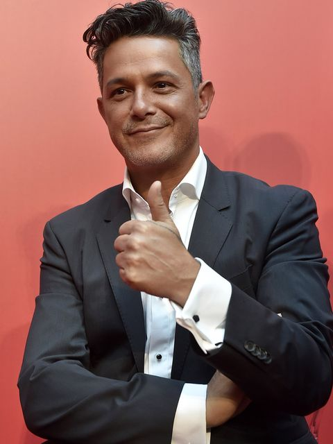 Suit, Formal wear, White-collar worker, Businessperson, Tuxedo, Gesture, Thumb, Business,