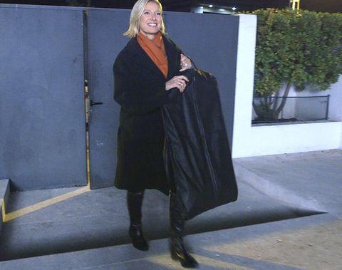 Boot, Costume, Overcoat, Cloak, Academic dress, Mantle, Shawl, Scarf, Costume design, Vintage clothing,