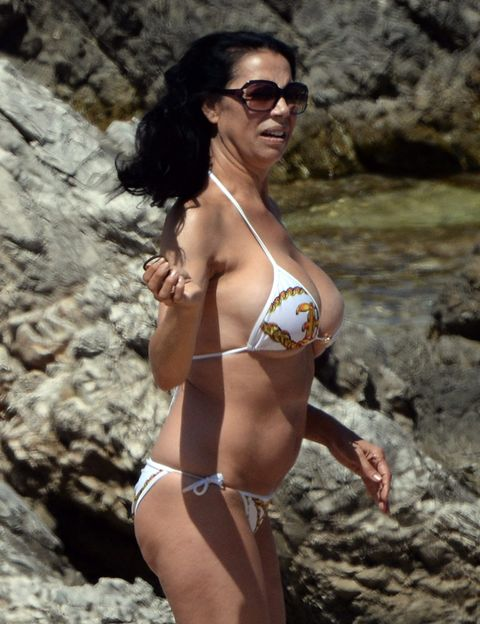 Clothing, Brassiere, Glasses, Skin, Sunglasses, Swimwear, Photograph, Swimsuit top, Joint, Chest,