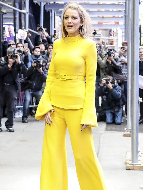 Yellow, Street fashion, Clothing, Fashion model, Fashion, Shoulder, Pantsuit, Suit, Haute couture, Footwear,
