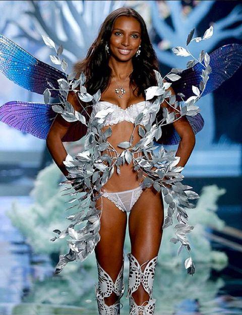 Mouth, Fashion model, Fashion, Beauty, Thigh, Electric blue, Model, Wing, Abdomen, Costume design,