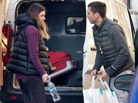 Vehicle door, Water bottle, Bag, Bottle, Plastic bottle, Automotive window part, Baggage, Car seat, Minibus,