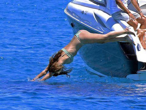 Blue, Human leg, Fluid, Liquid, Azure, Aqua, Electric blue, Watercraft, Sandal, Ankle,