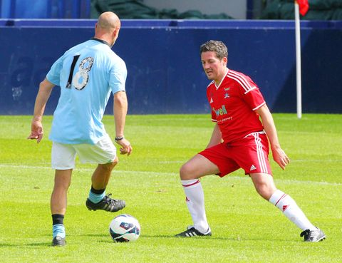 Footwear, Ball, Football, Soccer ball, Grass, Sports equipment, Sport venue, Jersey, Ball game, Sports uniform,