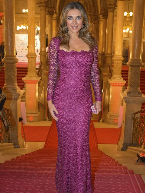 Clothing, Dress, Carpet, Red carpet, Gown, Fashion, Purple, Flooring, Haute couture, Shoulder,