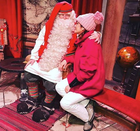 Santa claus, Red, Christmas, Christmas eve, Fictional character, Human body, Leg, Lap, Event, Holiday,