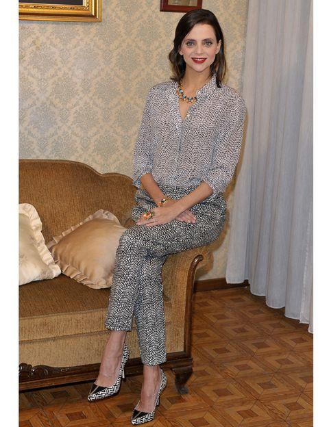 Human, Sleeve, Human leg, Joint, Interior design, Curtain, Sitting, Fashion, Beauty, Comfort,
