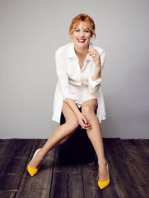 White, Leg, Sitting, Clothing, Human leg, Beauty, Yellow, Skin, Fashion, Footwear,