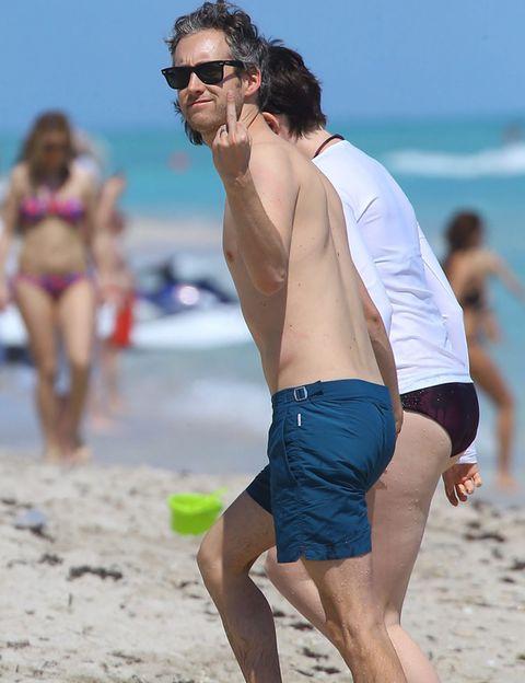 Eyewear, Vision care, Leg, Glasses, Fun, People on beach, Human leg, board short, Swimwear, Summer,