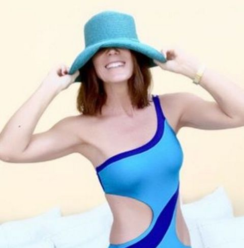 Clothing, Blue, Finger, Hat, Human body, Shoulder, Photograph, Joint, Standing, Elbow,