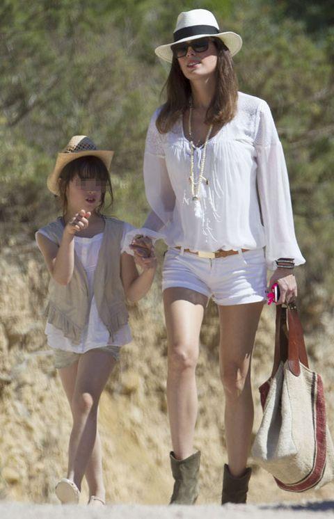 Clothing, Hat, Leg, Sleeve, Human body, Summer, Fashion accessory, Sun hat, Shorts, Headgear,