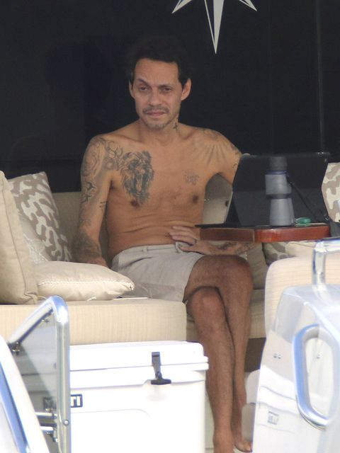 Barechested, Leg, Muscle, Arm, Briefs, Vacation, Sitting, Chest hair, Human body, Chest,