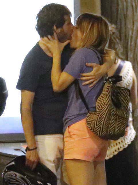 Bag, Interaction, Luggage and bags, Kiss, Curtain, Romance, Love, Friendship, Gesture, Hug,