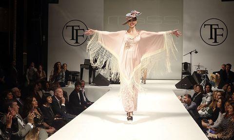 Fashion model, Fashion, Fashion show, Runway, Clothing, Shoulder, Fashion design, Dress, Beauty, Haute couture,
