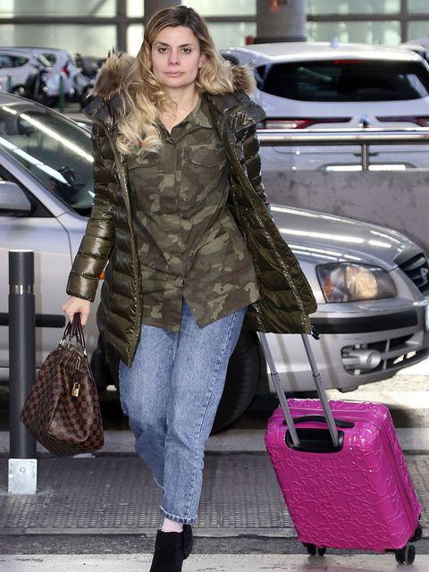 Clothing, Street fashion, Fashion, Fur, Snapshot, Outerwear, Footwear, Coat, Jeans, Jacket,