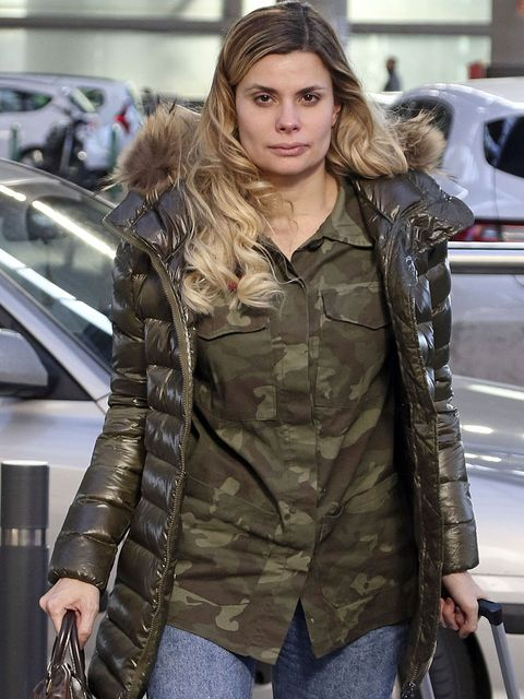 Clothing, Outerwear, Jacket, Fur, Fashion, Leather, Coat, Overcoat, Long hair, Camouflage,