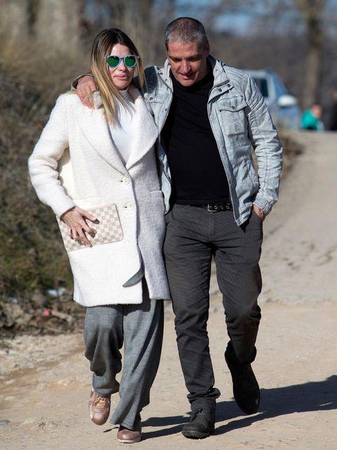 Clothing, Eyewear, Sleeve, Trousers, Textile, Jacket, Outerwear, Sunglasses, Coat, Style,