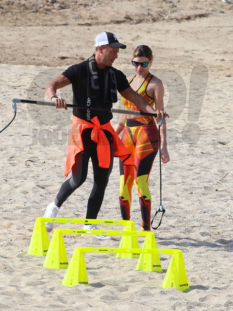 Shoe, Hat, Goggles, Sunglasses, Adventure, Playing sports, Active pants, Sand, Outdoor shoe, Tights,