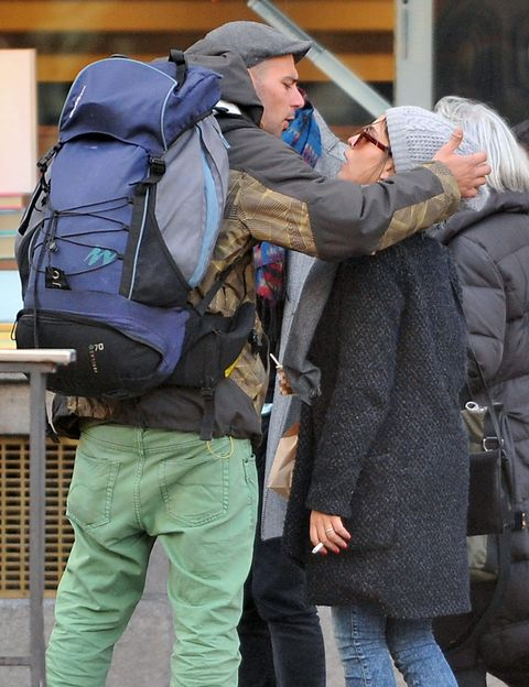 Hat, Bag, Luggage and bags, Sun hat, Overcoat, Fur, Fedora, Backpack, Pocket, Baggage,