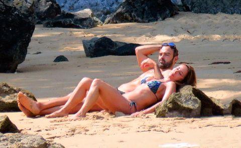 Sun tanning, Bikini, Photograph, Swimwear, Beach, Fun, Vacation, Muscle, Sand, Undergarment,