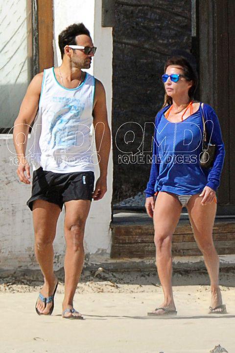 Eyewear, Clothing, Sunglasses, Fashion, Shorts, Leg, Street fashion, Electric blue, Thigh, Footwear,