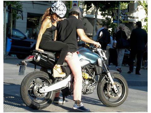 Footwear, Tire, Motorcycle, Automotive tire, Land vehicle, Shoe, Fender, Automotive lighting, Helmet, Automotive wheel system,