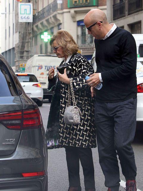 Street fashion, Luxury vehicle, Tights, Fashion, Sunglasses, Snapshot, Eyewear, Vehicle door, Car, Vehicle,