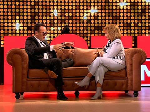 Couch, Television program, Furniture, Comfort, Sitting, Interior design, Chair,