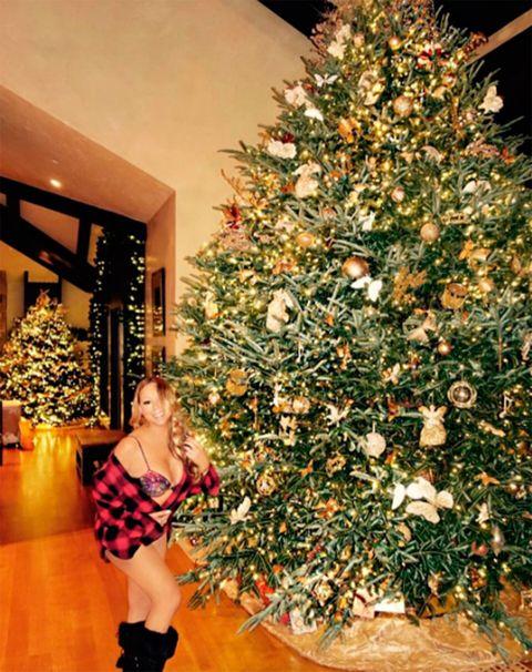 Christmas decoration, Lighting, Event, Interior design, Christmas tree, Christmas ornament, Room, Red, Interior design, Dress,