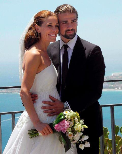 Bride, Wedding dress, Gown, Wedding, Photograph, Ceremony, Formal wear, Facial expression, Bridal clothing, Dress,