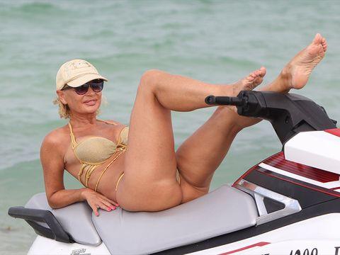 Jet ski, Personal water craft, Boating, Vehicle, Recreation, Sun tanning, Vacation, Blond, Bikini, Watercraft,