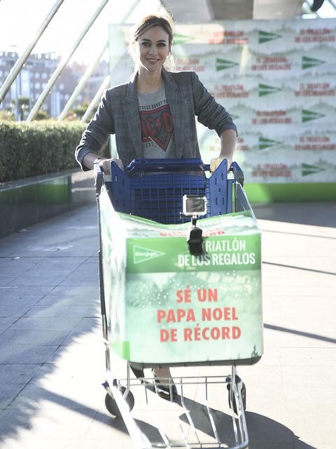 Green, Transport, Hand luggage, Shopping cart, Vehicle, Street fashion, Travel, Cart, Baggage, Luggage and bags,