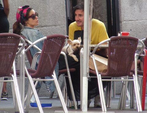 Human, Product, Furniture, Chair, Outdoor furniture, Sunglasses, Dog breed, Companion dog, Outdoor table, Goggles,