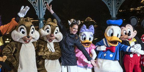 Mascot, Animated cartoon, Fun, Event, World, Vacation, Costume, Recreation, Theatrical property, Fur,