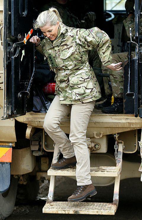 Leg, Shoe, Human body, Microphone, Camouflage, Uniform, Military camouflage, Employment, Military organization, Machine,