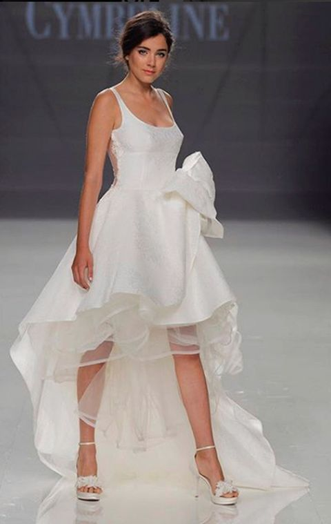 Clothing, Hairstyle, Shoe, Shoulder, High heels, Joint, Fashion show, White, Dress, Style,