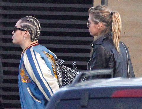 Ear, Jacket, Street fashion, Leather jacket, Headpiece, Conversation, Blond, Hair accessory, Leather,