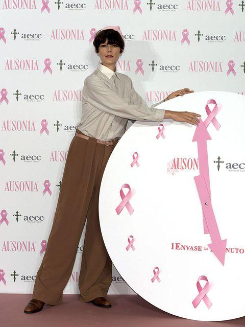 Sleeve, Pink, Magenta, Waist, Suit trousers, Peach, Costume, Fashion design, Foot, Alarm clock,