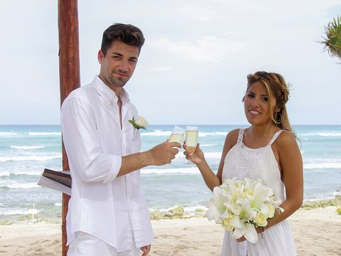 Clothing, Event, Coastal and oceanic landforms, Dress, Dress shirt, Bouquet, Petal, Photograph, Bridal clothing, Happy,