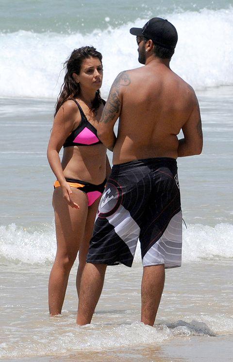 Leg, Fun, People on beach, Human body, Brassiere, Cap, Standing, Swimwear, Summer, People in nature,